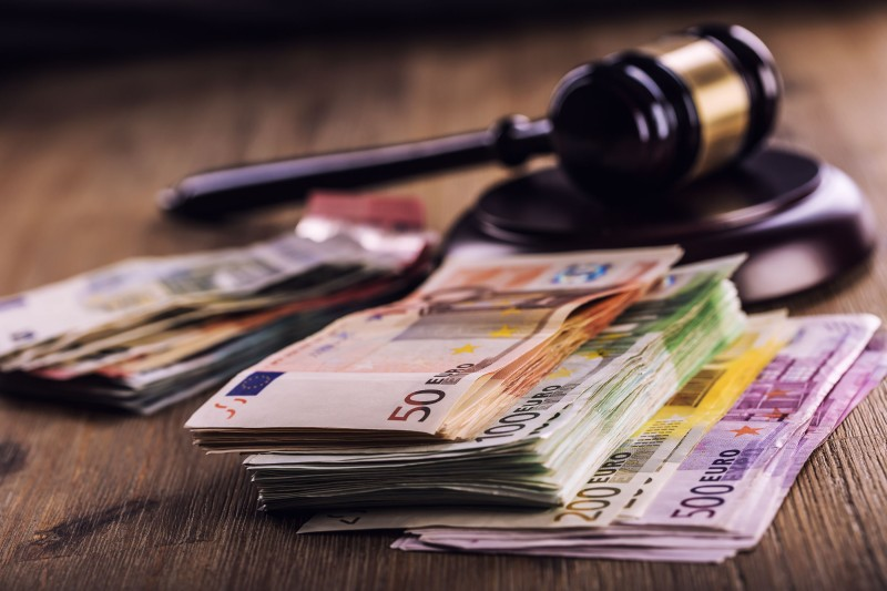 udge's hammer gavel. Justice and euro money. Euro currency. Court gavel and rolled Euro banknotes. Representation of corruption and bribery in the judiciary.