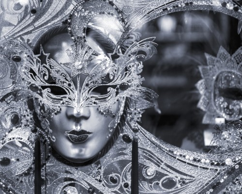 Black and white picture of traditional carnival mask in Venice Italy